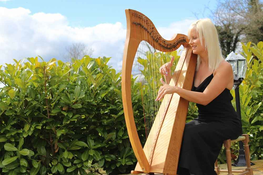 Caroline Stapleton Playing a Harp