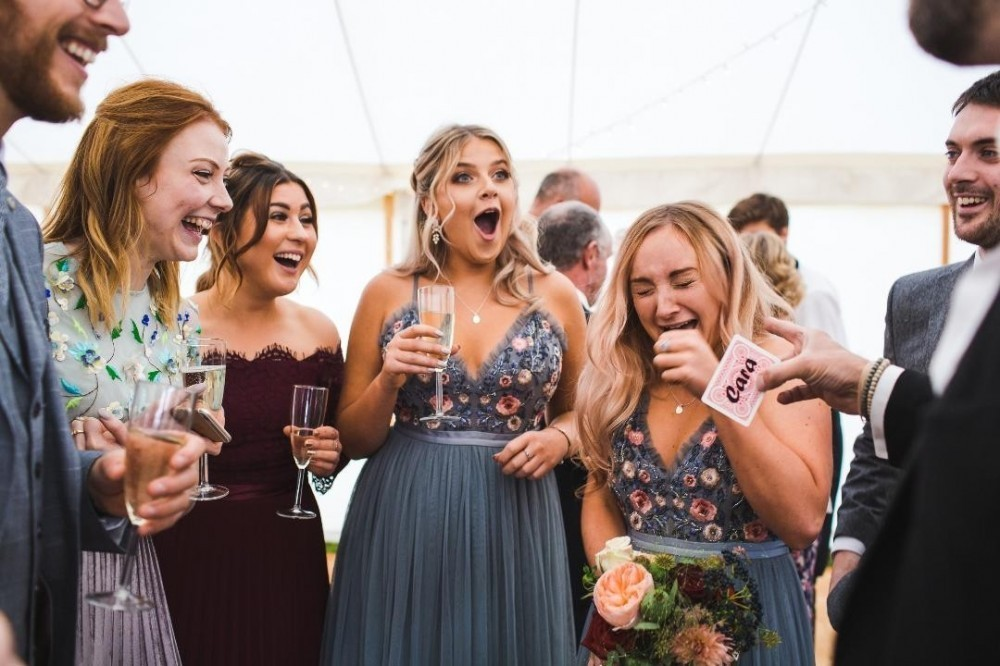 wedding magician entertaining bridesmaids
