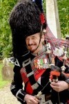 Pipe Major David Waterton-Anderson, KSG, KMM, OLJ, OMLJ.