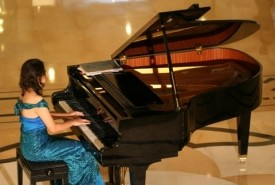 R Excelicia Cunville - Pianist / Singer