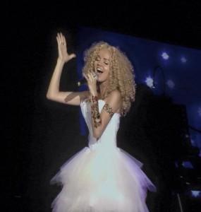 Singing. Dancing. Composing live.  - Female Singer