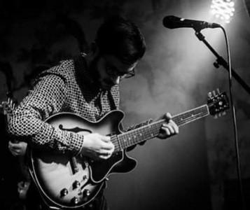x - Acoustic Guitarist / Vocalist